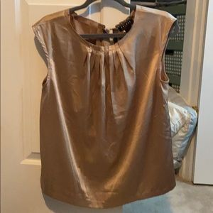 Brown shiny top with detailing